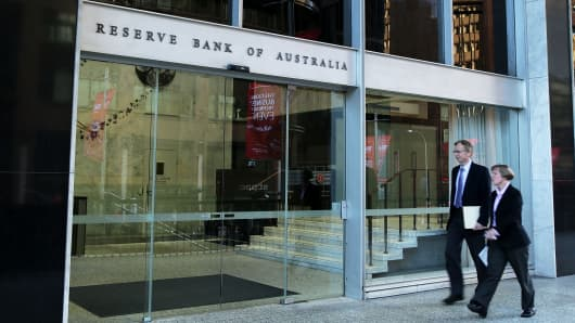 A man and a women walk into the Reserve Bank of Australia headquarters in Sydney, Australia.