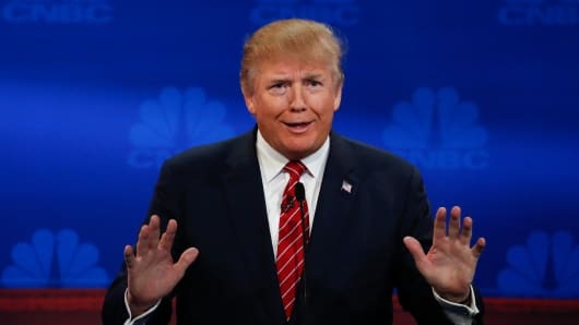 Donald Trump gestures at the CNBC GOP Debate in Boulder, Colorado.