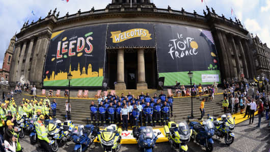 French Republican Guards, working on Tour de France security, pose for a family picture in front of the city hall of Leeds, northern England, on July 4, 2014, before the start of the 101st edition of the Tour de France cycling race.