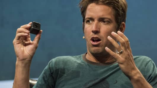 Nick Woodman, founder and chief executive officer of GoPro Inc., holds the GoPro HERO4 Session camera.