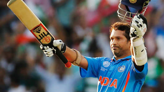 Sachin Tendulkar of India raises his bat on scoring his century during the Group B ICC World Cup Cricket match between India and South Africa on March 12, 2011, in Nagpur, India.
