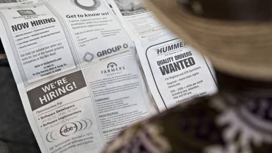 A job seeker looks over job listings during the Quad Cities career fair in Moline, Illinois.