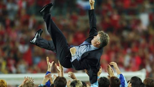 South Korea's players toss their Dutch coach, Guus Hiddink, in the air in celebration on June 29, 2002, at the World Cup Stadium in Daegu, South Korea, after their surprise fourth-place finish in the World Cup.
