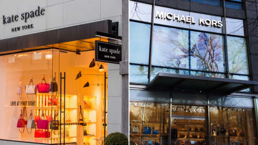 Kate Spade and Michael Kors storefronts.