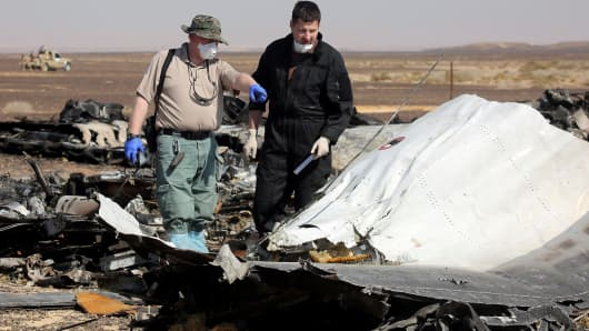 Egyptian officials inspect the crash site of Russian Airliner in Suez, Egypt on November 01, 2015. A Russian Airbus-321 airliner with 224 people aboard crashed in Egypt's Sinai Peninsula on yesterday.