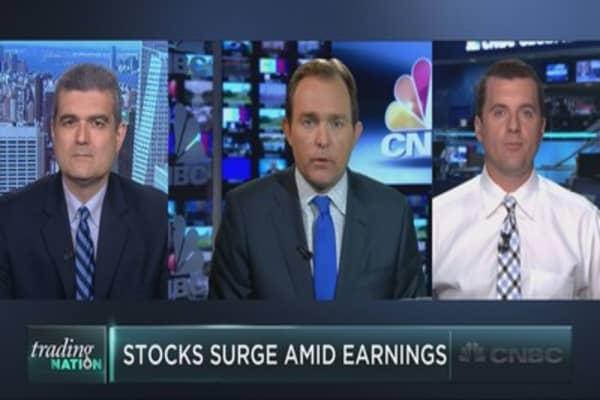Stocks surge amid earnings