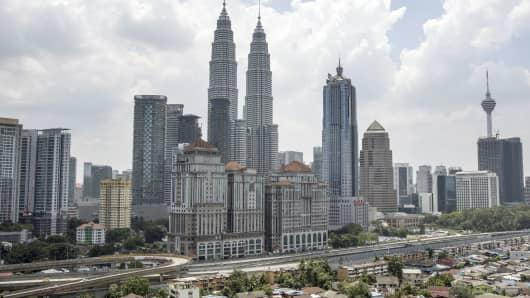 The Petronas Twin Towers stand in Kuala Lumpur, Malaysia.