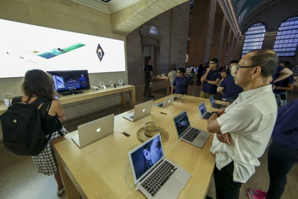 People watch Apple's announcement of new versions of products at an Apple Store in New York on Sept. 9, 2015.
