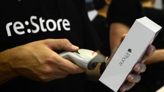 An employee scans the box of iPhone 6 in re:Store at Europeisky Shopping Mall as iPhone 6 and iPhone 6 Plus retail sales begin in Russia on September 25, 2014.