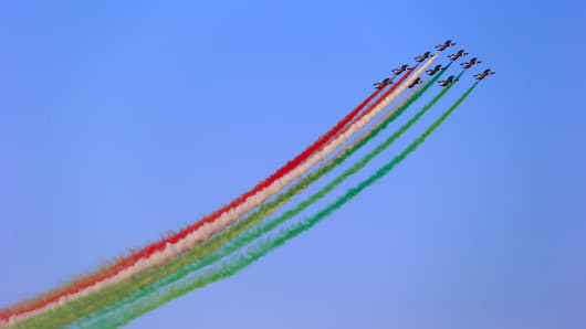 Members of the Frecce Tri Colori aerobatic display squad perform an aerial display on the opening day of the 14th Dubai Air Show at Dubai World Central (DWC) in Dubai, United Arab Emirates.