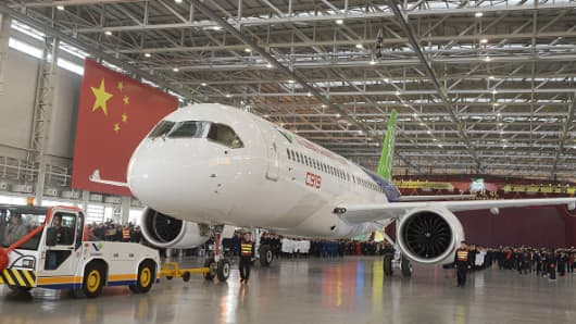 China's first self-developed large passenger jetliner C919 is presented after it rolled off the production line on November 2, 2015 in Shanghai.