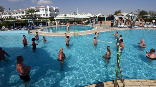 Tourists play volleyball in a swimming pool at a hotel in the Egyptian resort of Sharm el-Sheikh on Nov. 7, 2015.