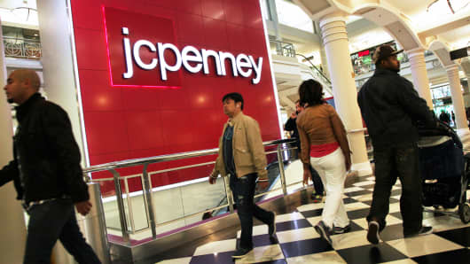 Shoppers pass a J.C. Penney store in New York.