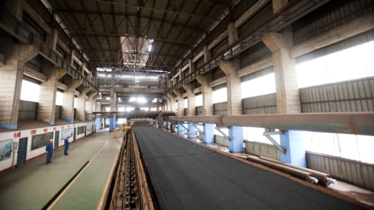 Iron ore moves through the production process at the China Oriental Group Co. steel plant in Tangshan, Hebei province, China, on Saturday, Aug. 29, 2009.