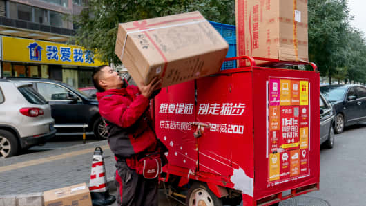 A JD logistics staff delivering goods in Beijing during the Double 11 special sales holiday.