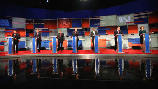Presidential candidates Ohio Governor John Kasich (L-R), Jeb Bush, Sen. Marco Rubio (R-FL), Donald Trump, Ben Carson, Ted Cruz (R-TX), and Carly Fiorina take the stage in the Republican Presidential Debate November 10, 2015 in Milwaukee, Wisconsin.