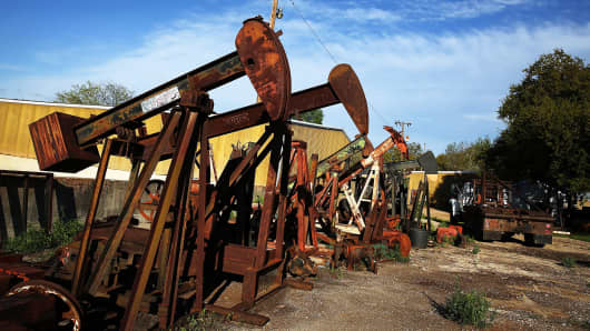 "Rusted out ""pump-jacks"" in the oil town of Luling, Texas."