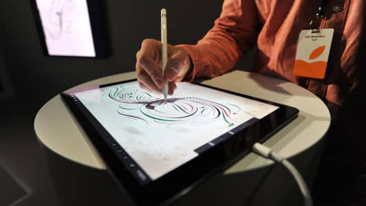 An Apple employee demonstrates how to use the new Apple Pencil for the iPad Pro at a media event in San Francisco.