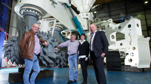 Kevin Cain, VP, Projects, Nautilus, Mike Johnston, CEO, Nautilus, Shontel Norgate, CFO, Nautilus and Andrew Hodgson, CEO SMD in front of the Auxiliary Cutter.