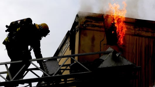 A firefighter fights a fire in Huntington Park, California.