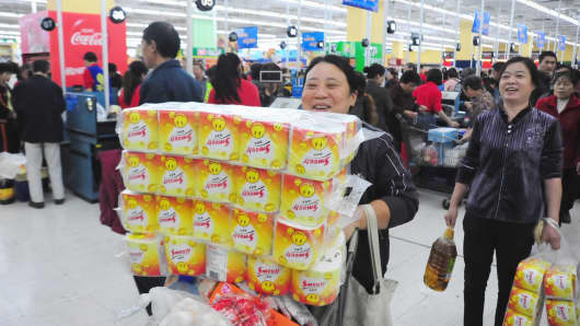 People purchase goods at a Walmart supermarket