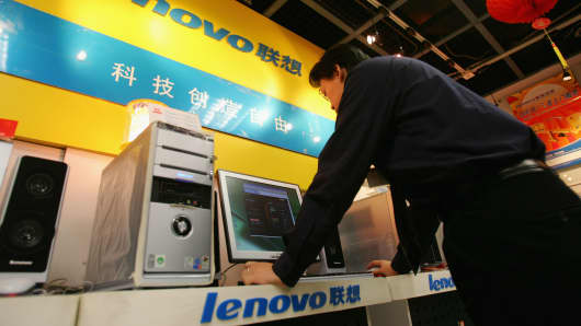 A salesman use a Lenovo computer at a store January 28, 2005 in Beijing, China.
