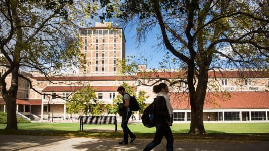 People walk through the University of Colorado campus in Boulder, Colorado.