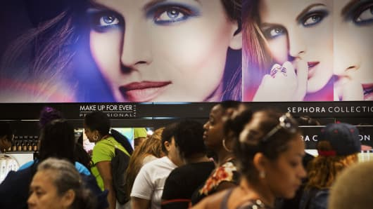 Customers browse the make-up area at a Sephora USA store inside a J.C. Penney store in Brooklyn, New York.