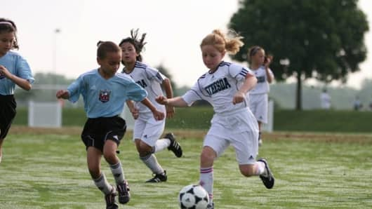 Katie Rothstein (R) playing soccer.