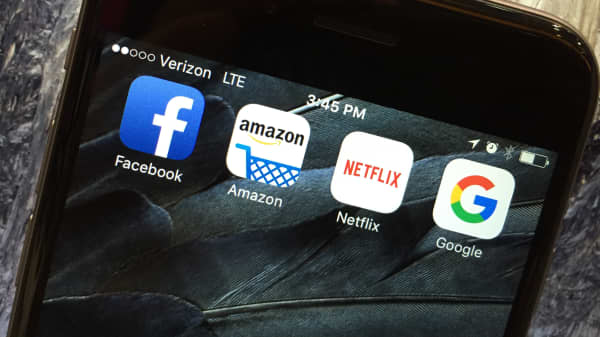FANG (Facebook, Amazon, Netflix and Google) apps on a smartphone.