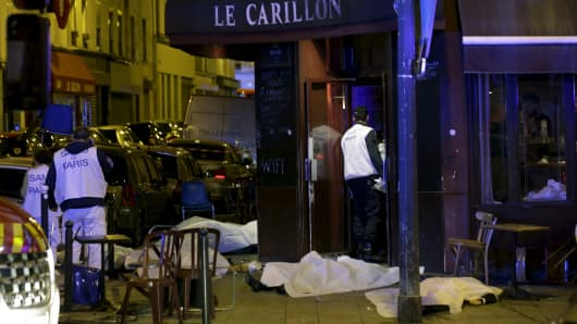 A general view of the scene that shows the covered bodies outside a restaurant following a shooting incident in Paris, France, November 13, 2015.