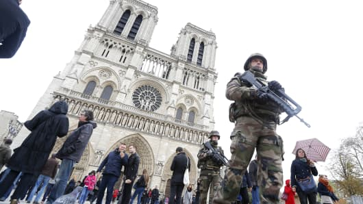 French military patrol near the Notre Dame Cathedral the day after a series of deadly attacks in Paris, France, November 14, 2015.
