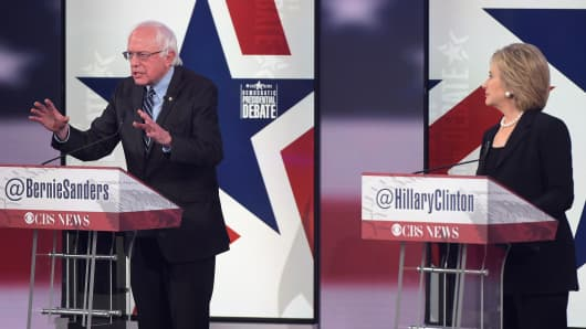 Democratic Presidential hopeful Hillary Clinton (R) looks on as Bernie Sanders speaks during the second Democratic presidential primary debate in the Sheslow Auditorium of Drake University on November 14, 2015 in Des Moines, Iowa.