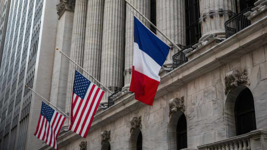 French and U.S. flags fly at half-mast on Nov. 16, 2015, outside the New York Stock Exchange in honor of the victims of the terrorist attacks in Paris last week.