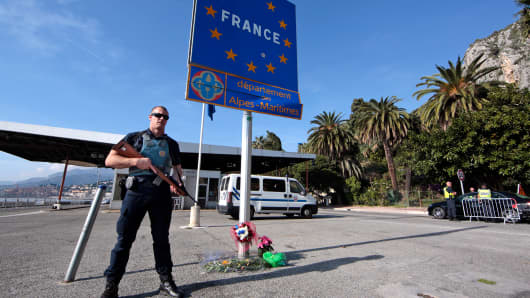 A French police officer stands guard at the Franco-Italian border in Menton, France, on Nov. 15, 2015, after the deadly attacks in Paris on Friday.