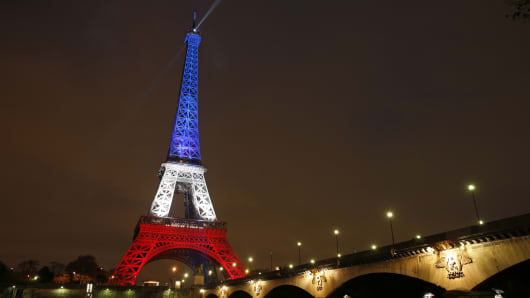 The Eiffel Tower is lit with the blue, white and red colors of the French flag in Paris on November 16, 2015, to pay tribute to the victims of a series of deadly attacks on Friday in the French capital.