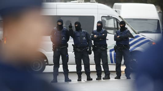 Belgian police take part in an operation at district of Molenbeek in Brussels, Belgium, on Nov. 16, 2015.