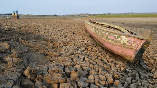 A wooden boat is stranded on the riverbed of the Dawuhan Dam during drought season in Madiun, Indonesia's East Java province, on Oct. 5, 2015.