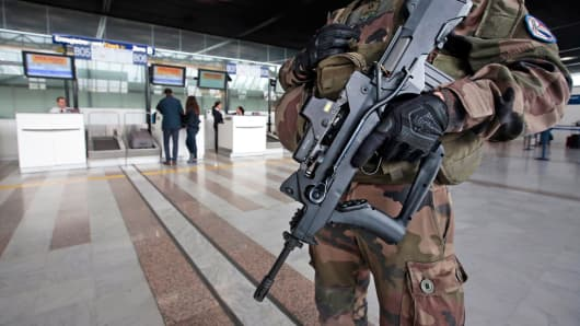 An armed French soldier patrols the Nice international airport in France, Nov. 17, 2015, as security increases after last Friday's series of deadly attacks in Paris.