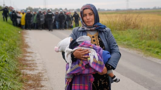 Fatima from Syria (front) walks ahead of other migrants as they make their way on foot after crossing the Croatian-Slovenian border, in Rigonce, Slovenia, October 22, 2015.