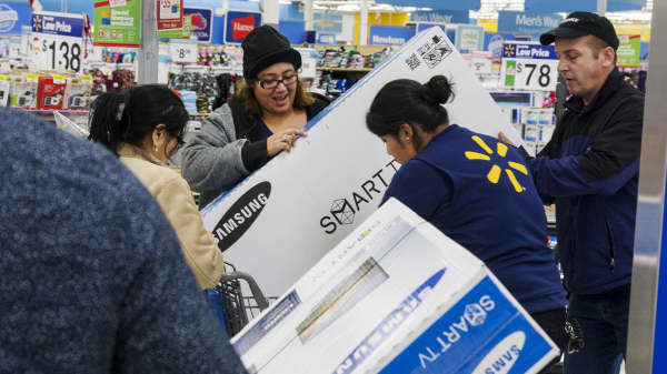 Shoppers load a television set into their cart at a Walmart store in Secaucus, New Jersey.