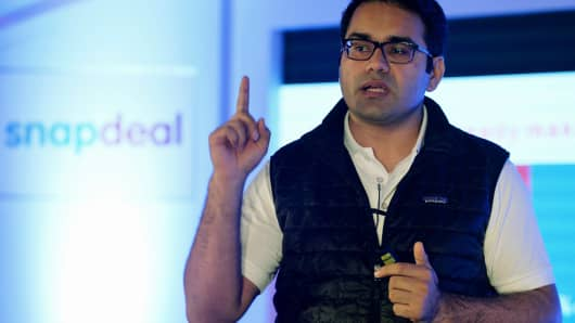Co-Founder and CEO of Snapdeal, Kunal Bahl, gestures while addressing the media in Bangalore on April 8, 2015.