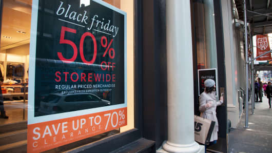 Black Friday sale signs at a retail store in New York.