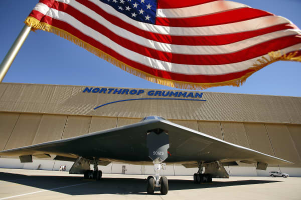 The US flag flies near the U.S. Air Force's B-2 Spirit Stealth bomber 'Spirit of Georgia' at the Northrop Grumman Corp. facility at U.S. Air Force Plant 42 in Palmdale on July 17, 2014
