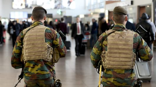 Military police soldiers patrol the Brussels Airport on November 18, 2015 in Zaventem, eastern Brussels.