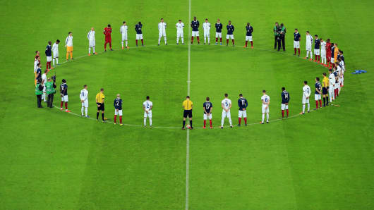 Players come together for the minutes silence remember those who lost their lives in the recent Paris attack prior to the International Friendly match between England and France at Wembley Stadium on November 17, 2015 in London, England.