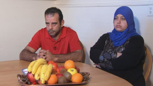 Syrian refugees Hussam Al Roustom and wife Suha in Jersey City, N.J.