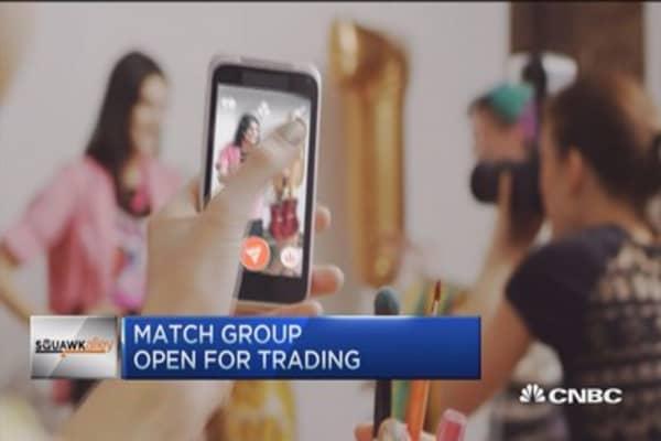 Tinder parent Match Group opens at $13.50 a share