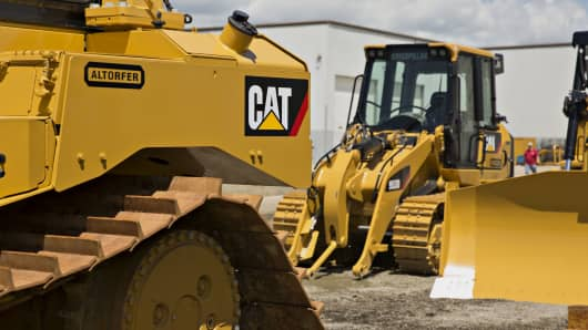 Caterpillar Inc. bulldozers sit outside the Altorfer Cat dealership in East Peoria, Illinois.