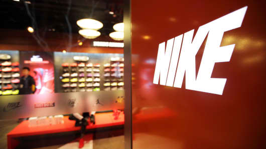 The Nike Inc. logo is displayed at the entrance to the company's store in the East Nanjing Road shopping area of Shanghai, China.